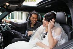 Gorgeous wedding couple in car Stock Image