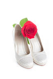 Gorgeous wedding shoes white with a red rose Royalty Free Stock Photos