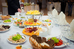 Gorgeous wedding table served with fruits and salads Royalty Free Stock Photo