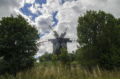 Gorgeous windmill among the trees Royalty Free Stock Photography