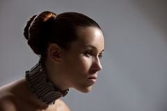Gorgeous woman. Beautiful woman with tight hairstyle Royalty Free Stock Photos