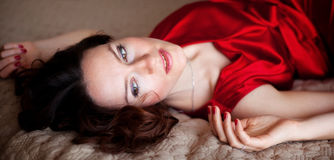 Gorgeous woman. On the bed royalty free stock photos