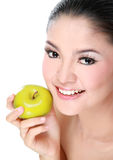 Gorgeous woman with apple Royalty Free Stock Photography