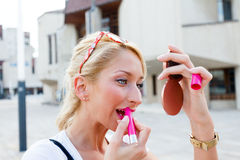 Gorgeous Woman Applying Lip Gloss Royalty Free Stock Photo