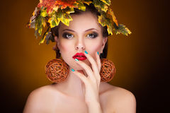 Gorgeous woman with autumn leaves in head. Fashion, glamour and art style conept. Beauty and season fall royalty free stock images