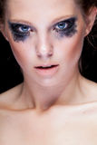 Gorgeous woman with black crying make up Stock Photos