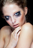 Gorgeous woman with black crying make up Stock Images