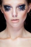 Gorgeous woman with black crying make up Royalty Free Stock Photography