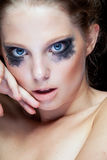 Gorgeous woman with black crying make up Stock Photo