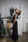 Gorgeous woman in black dress. new year celebration Stock Photos