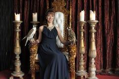 Gorgeous woman in a black dress Stock Photos