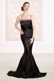 Gorgeous woman in black long dress stock image