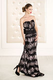 Gorgeous woman in black long dress Royalty Free Stock Photos