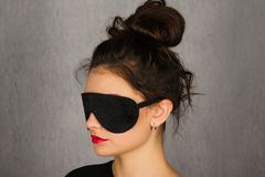 Gorgeous woman with black sleep mask - Image. Gorgeous young woman with black sleep mask - Image stock photography