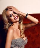 Gorgeous woman with blond hair and bright makeup,wearing luxurio Stock Photo