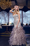 Gorgeous woman with blond hair in elegant dress posing in luxury interior Royalty Free Stock Images