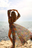 Gorgeous woman with blond hair in elegant swimsuit  posing on beach Royalty Free Stock Images