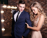 Gorgeous woman with blond hair and handsome man in elegant clothes Royalty Free Stock Photos