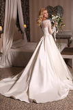 Gorgeous woman with blond hair wears luxurious wedding dress with bouquet. Fashion studio photo of gorgeous bride with blond hair, in luxurious wedding dress Stock Photography