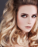 Gorgeous Woman with Blonde Hair. Permed Curly Hair. Style Royalty Free Stock Photo