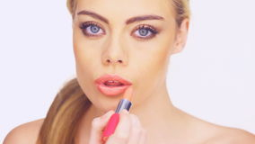 Gorgeous woman blowing a lipstick kiss stock footage
