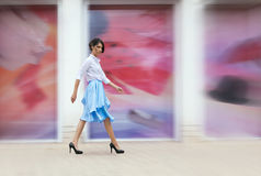 Gorgeous woman in blue skirt outside Stock Image