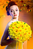 Gorgeous woman with bouquet of flowers Stock Photos