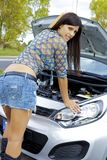 Gorgeous woman with broken engine worried Stock Photography