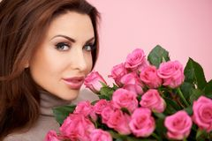 Gorgeous woman with a bunch of roses Stock Photos