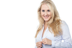 Gorgeous woman buttoning her shirt Stock Images