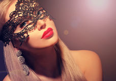 Gorgeous woman in carnival mask Stock Photos