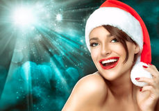 Gorgeous woman in a Christmas Santa hat. Beautiful Big Smile Royalty Free Stock Photography