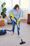Gorgeous woman cleaning with vacuum cleaner carpet Stock Image