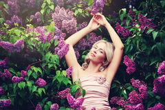 Gorgeous Woman on Colorful Lilac Background Stock Photo