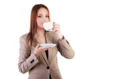 Gorgeous woman with a cup os coffe in hands isolated on white ba Stock Images
