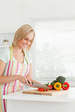 Gorgeous woman cutting red pepper Royalty Free Stock Image