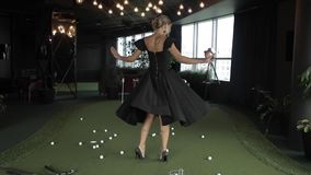 Gorgeous woman dancing on golf court.