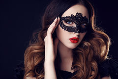 Gorgeous woman with dark hair and blue eyes, with  mask on face Royalty Free Stock Images