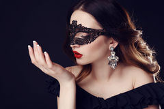 Gorgeous woman with dark hair and blue eyes, with  mask on face Royalty Free Stock Photos