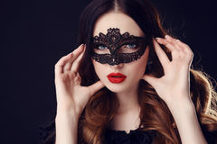 Gorgeous woman with dark hair and blue eyes, with  mask on face Royalty Free Stock Photography