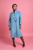 Gorgeous woman with dark hair in elegant blue coat Stock Image