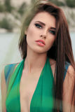 Gorgeous woman with dark hair in elegant swimsuit posing on beach Stock Photography