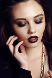 Gorgeous  woman with dark hair and evening makeup Royalty Free Stock Photos