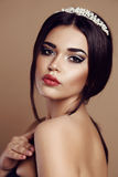 Gorgeous  woman with dark hair and evening makeup Royalty Free Stock Image