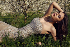 Gorgeous woman with dark hair posing in spring garden royalty free stock photos