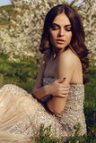 Gorgeous  woman with dark hair posing in spring garden Royalty Free Stock Photography