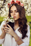 Gorgeous  woman with dark hair posing in spring garden Royalty Free Stock Images
