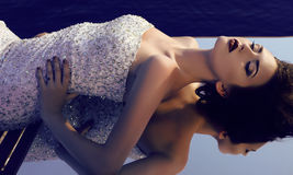 Gorgeous woman with dark hair  wearing luxurious sequin dress Stock Photography