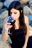 Gorgeous woman drinking red wine before dinner party Stock Photography
