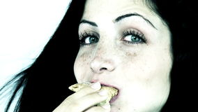 Gorgeous woman eating croissant against diet stock footage